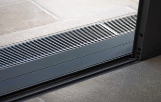 Threshold drainage systems for Balconies in Multi-Residential Design
